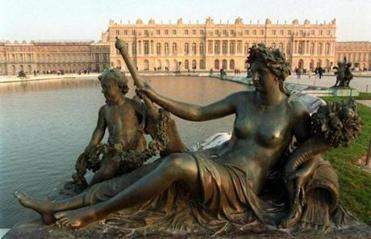 The palace of Versailles is pictured behind a fountain.