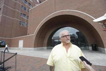 Steve Davis, brother of alleged murder victim Debra Davis, answered a reporter's question outside federal court.