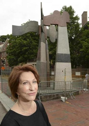 "Cynthia Hadzi, the wife of the late sculptor Dimitri Hadzi, in front of his sculpture ""Omphalos."""