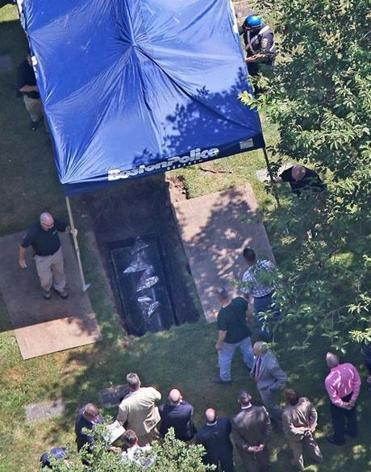 As helicopters from several news outlets whirred above Friday, more than 20 people were at the site in Peabody when the remains of Albert DeSalvo were exhumed.