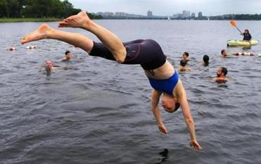 A swimmer dove into the Charles River in July.