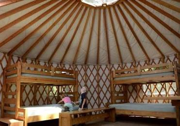 Siblings Jen, 3, and Alex Downer 5, of Stoneham explored the inside of a yurt at Peddock Island where they came for an overtnight visit.