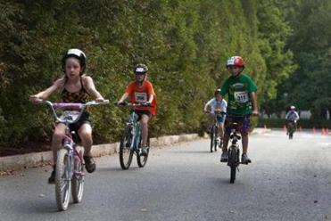 Caris Mann (from left), Megan Greene, and James Mastriani pedaled during the 3-mile bike ride segment of the race.