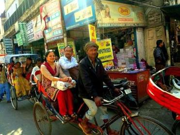 Bicycle pedicabs navigate the market streets of Old Delhi.