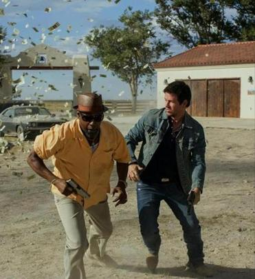 Denzel Washington (left) and Mark Wahlberg play undercover cops out to thwart a drug lord.