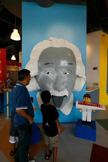 Visitors to the Legoland Discovery Center near Chicago can view a model of  Albert Einstein (above) and work on models (below).