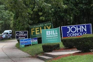 Mayoral candidates' signs in Jamaica Plain. The preliminary election could be decided by as few as 25,000 votes.
