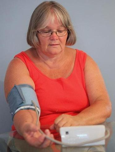 Sandra Rice, 61, takes her measurements daily to monitor chronic hypertension.