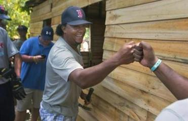 El Mamon, Dominican Republic- Globe Staff Photo by Stan Grossfeld---Pedro Martinex gives a fist bump to workers of Lindos Suenos a program which means Beautiful Dreams. U.S. teens and their Dominican counterparts work mornings together and play baseball in the afternoons.