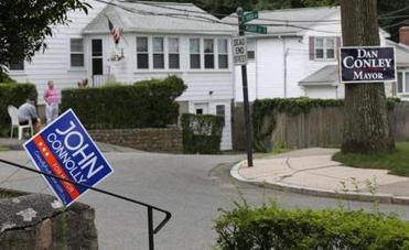 In West Roxbury, signs for Conley and Connolly compete.