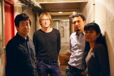 Fujii (right) with (from left) husband Natsuki Tamura, Peter Orins, and Christian Pruvost.