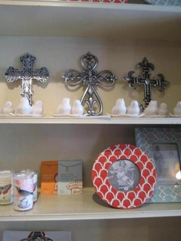 A selection of Ensemble's crosses, frames and ceramic birds.