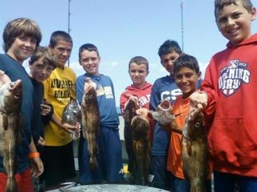 Youngsters showed off their catches from Monday, Aug 12.