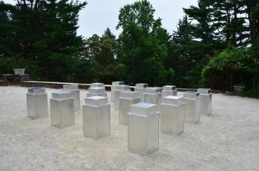 """Untitled (16 Garbage cans)"" made with park trash receptacles."