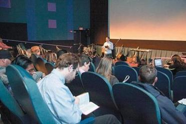 Allison, a 27-year-old evangelical Christian,  delivers his new church's first sermon at a Revere movie theater on Easter Sunday.