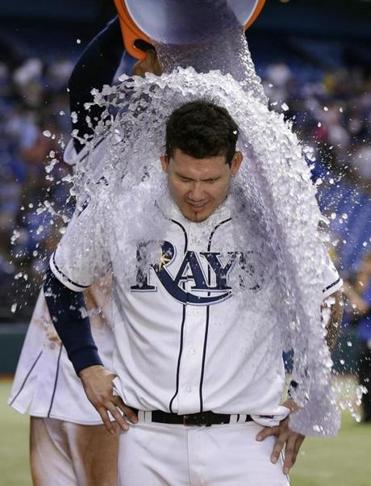 Jose Lobaton tripled in the winning run as the Rays' victory brought them to within one game of the Red Sox.