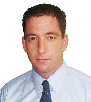 "Glenn Greenwald promised he was going ""to write much more aggressively"" on government snooping."