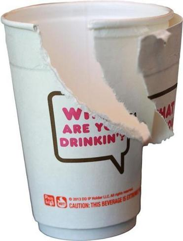 A Dunkin' cup made of doubled-walled paper is being tested in Brookline, but critics say Starbucks and McDonald's have done far more to help the environment.