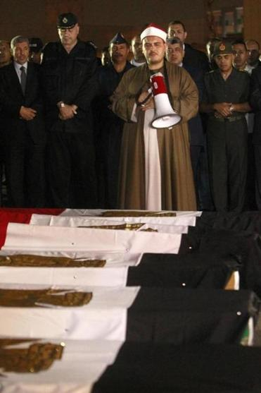 The caskets of Egyptian policemen killed on the  Sinai Peninsula arrived in Cairo Monday. Islamic militants killed 25 officers.