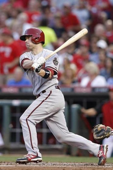 Aaron Hill's fourth-inning home run wasn't enough to slow down the Reds, who have won seven of their last nine games.
