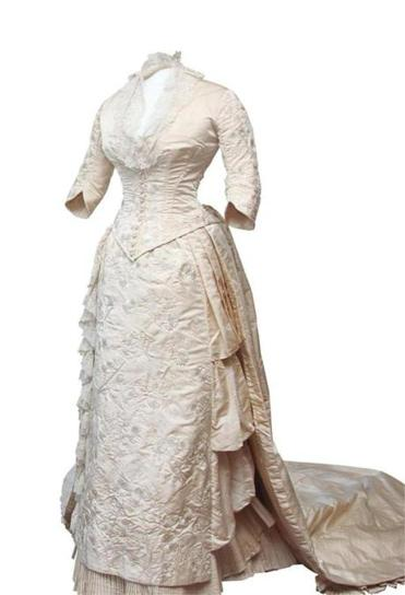 Bessie Pardee Van Wickle's 1882 wedding dress (right), shown here with an afternoon dress of the period