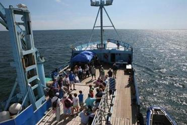 Visitors to the OCEARCH research ship listened to information about the program.