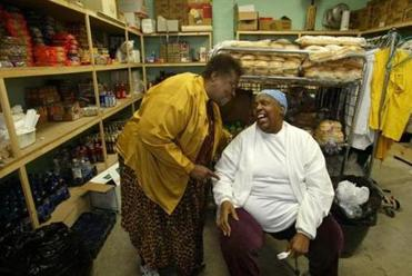 Idene 'Ma Siss' Wilkerson (right) incorporated Ma Siss's Place as a nonprofit to run a food bank and thrift shop.