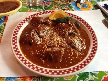 Red Iguana's Mexican menu includes a popular mole sauce, here on chunks of turkey.