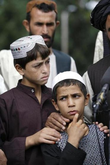 Afghan villagers Sadiquallah (left), who was shot by Robert Bales, and Khan spoke through an interpreter Friday.