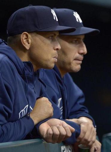Alex Rodriguez (left), watching with Andy Pettitte, played a reserve role on Sunday.