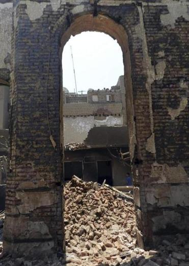 A burnt and destroyed Evangelical Church south of Cairo was in ruins earlier this month.