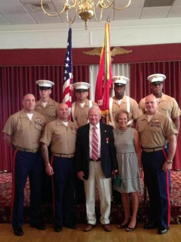 David Nugent and Marcia Nugent at the ceremony with Marines.