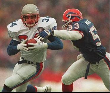 Former Patriot fullback Kevin Turner (left) can't get out a wheelchair because of amyotrophic lateral sclerosis.