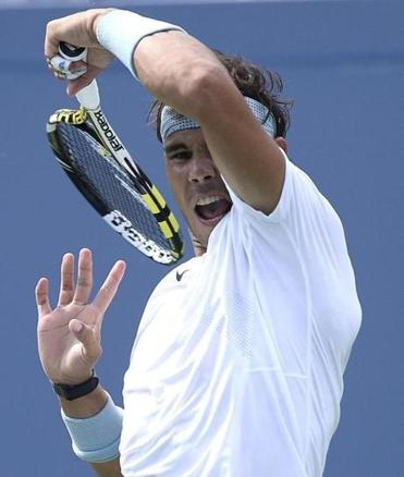 Rafael Nadal follows through on a forehand during his win over Ivan Dodig in the third round of the men's draw.
