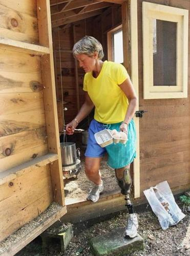 Robin Tarani collected eggs from the chicken coop on her property in Rutland. Tarani has trained daily for the Jimmy Fund Walk, sometimes walking several miles.