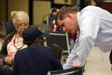 Walsh spoke with people at the Kit Clark Senior Services Center in Dorchester during a recent day of campaigning.