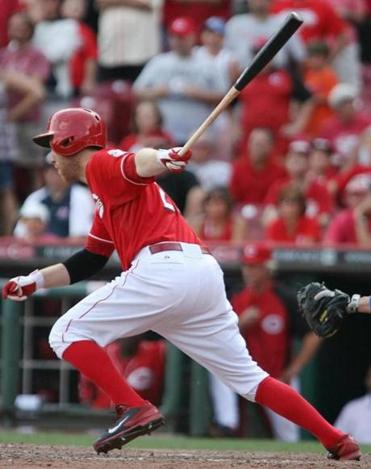 Todd Frazier follows through on his single in the 10th inning, which gave the Reds a victory over the Dodgers.