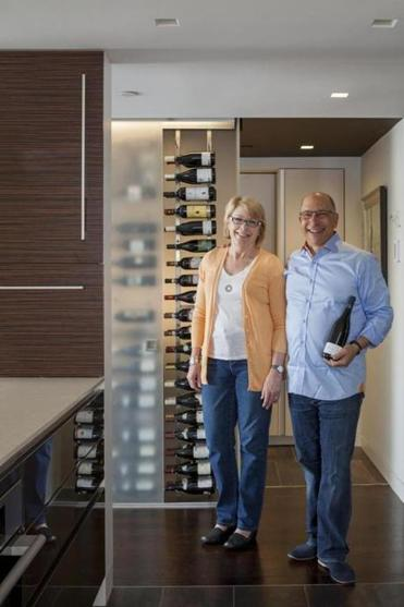 Mary Rivet and Chris Meyer's sleek new kitchen is designed around storage for their extensive wine collection.