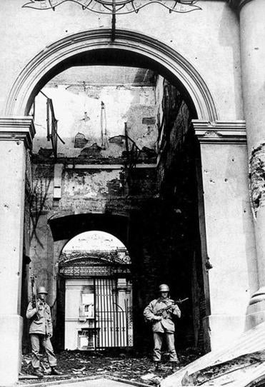 Chili is marking the 40th anniversary of General Augusto Pinochet's seizure of power. Above, soldiers guarded the bombed presidential palace in a Sept. 11, 1973, photo.