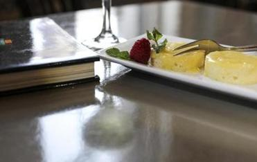 Olive oil cake with lemon curd is one of the desserts.