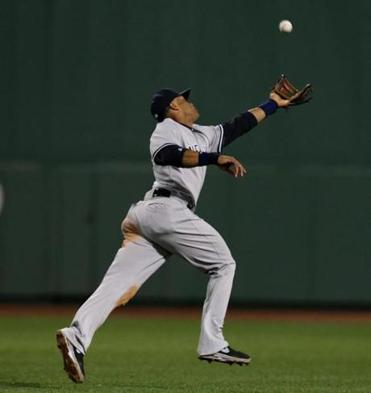 Yankees second baseman Robinson Cano makes an over-the-shoulder catch to rob Will Middlebrooks in the sixth.