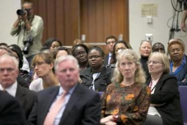 Audience members watched a monitor projecting the candidates at the forum.