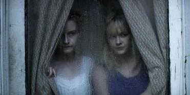 "Julia Garner (left) and Ambyr Childers in ""We Are What We Are,"" about a rural family that follows ritual cannibalism."
