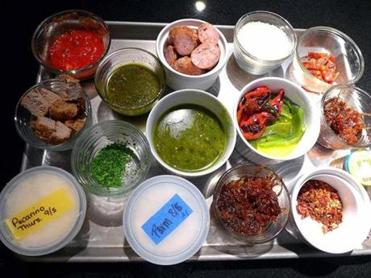 This tray represents only a portion of the pre-prepared toppings available to students at Jillyanna's Woodfired Cooking School. (David Lyon)