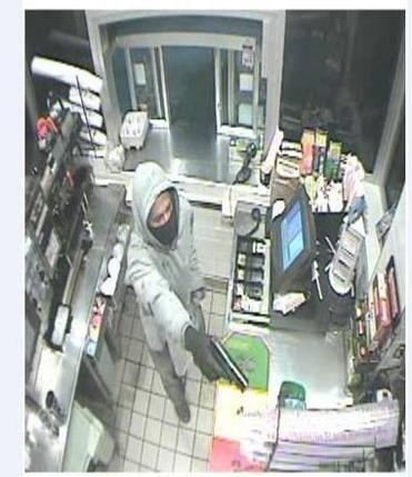 Surveillance photo from a Dunkin' Donuts robbery in Canton.