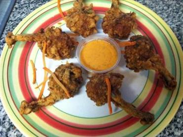 "The chicken ""lollipops"" at Tangra Masala are dry-rubbed with Chinese herbs and Indian spices."