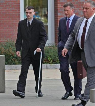 State trooper John  Basler (left) arrived  at Plymouth District Court Thursday for his arraignment.