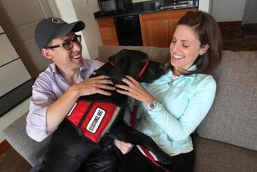 Jessica Kensky, her husband, Patrick Downes, and her new service dog named Rescue.