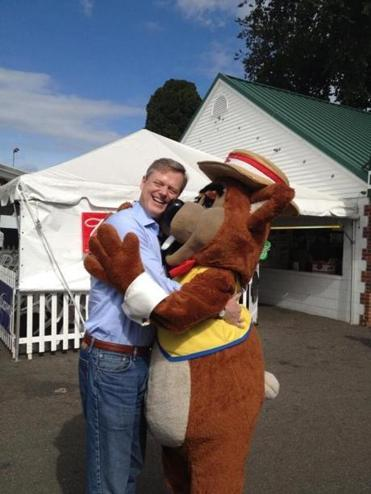 Charlie Baker got a hug at the Big E fair in West Springfield.