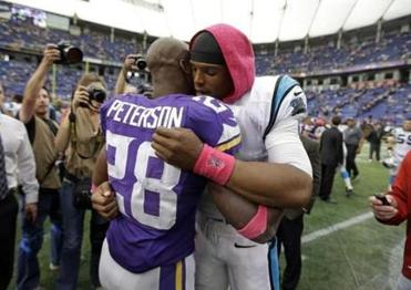 Following the game, Carolina QB Cam Newton hugged the Vikings' Adrian Peterson, who is grieving the death of his young son.